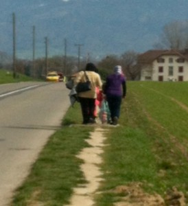 Residents of the Foyer d'Anières on the long trek to a bus stop