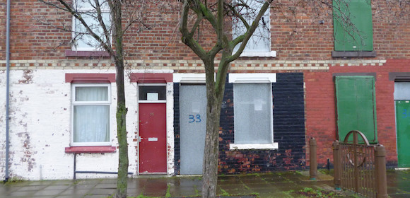 A red doored house used to house asylum seekers in Middlesbrough (© John Grayson)