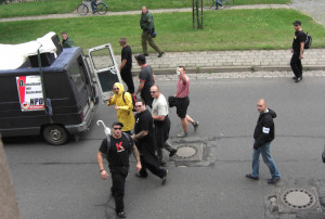 Two members of the banned Kameradschaft Hauptvolk, who worked as security guards, Daniel Kuhn, (red 'K' on black t-shirt) and Maurice Kindt (behind Kuhn, black trousers and shirt). Picture taken at neo-Nazi rally in 2007. (© apabiz)