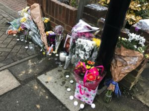 Flowers at a vigil for Kevin Clarke