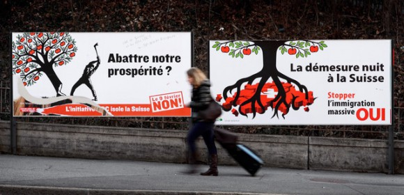 Campaigning for the vote. The 'No' campaign poster reads, 'Cut down our prosperity? the UDC initiative isolates Switzerland. On the 9th February vote no!' The 'Yes' campaign poster reads, 'The outrageous night of Switzerland. Stop mass immigration. YES!'