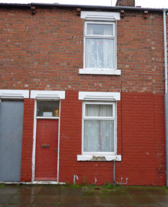 A red doored house used to house asylum seekers in the Gresham area of Middlesbrough (© John Grayson)