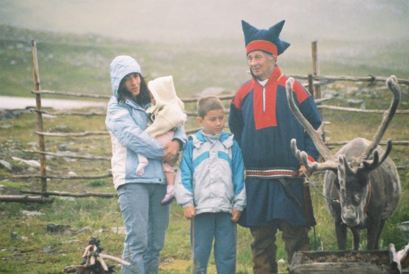 Sami people with a reindeer