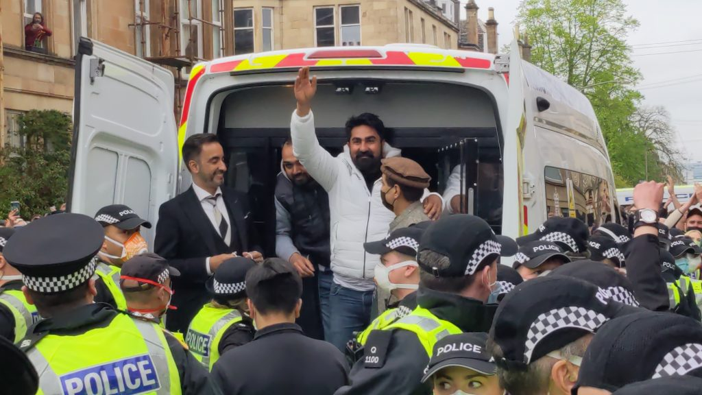 The two men detained in Glasgow leaving the immigration enforcement van.