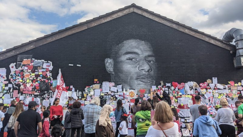 Marcus Rashford Mural surrounded by supporters