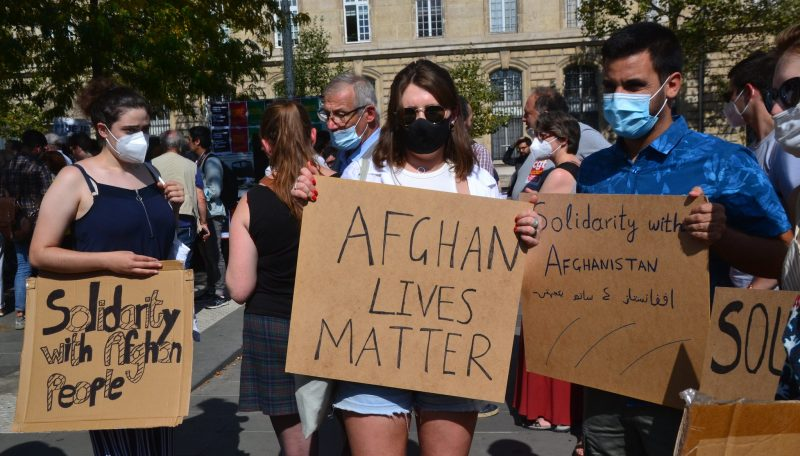 """Image showing people holding placards (such as """"Afghan Lives Matter"""") at an Afghanistan solidarity protest in Paris on 5 September 2021."""